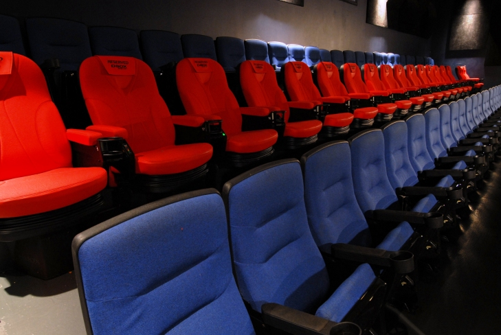 Rows of D-BOX chairs lined up in a movie theatre. (Courtesy of D-BOX)